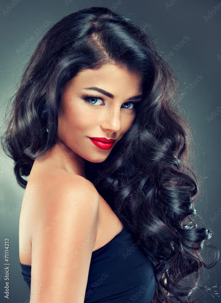 Fotografie, Obraz  Model brunette with long curly hair