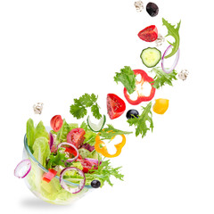 FototapetaFresh salad with flying vegetables ingredients