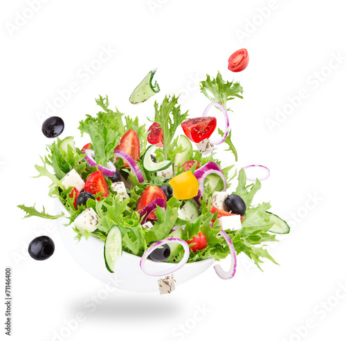 Carta da parati Fresh salad with flying vegetables ingredients