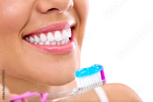 Valokuva  woman with healthy teeth holding a tooth-brush
