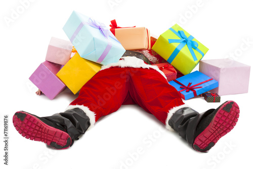 santa claus too tired to lie on floor with many gift boxes Canvas Print