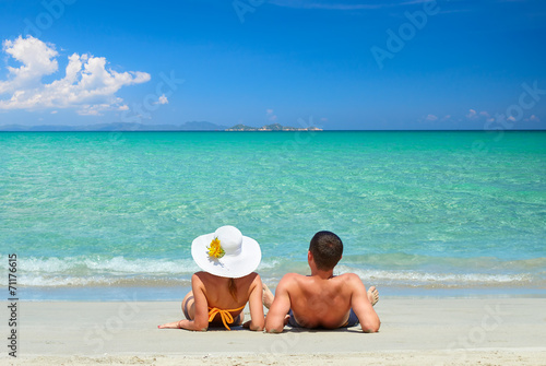 Couple on a tropical beach Canvas Print