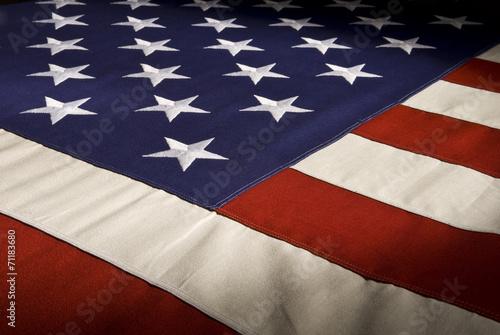 Valokuva American Flag Close-up With Dramatic Lighting