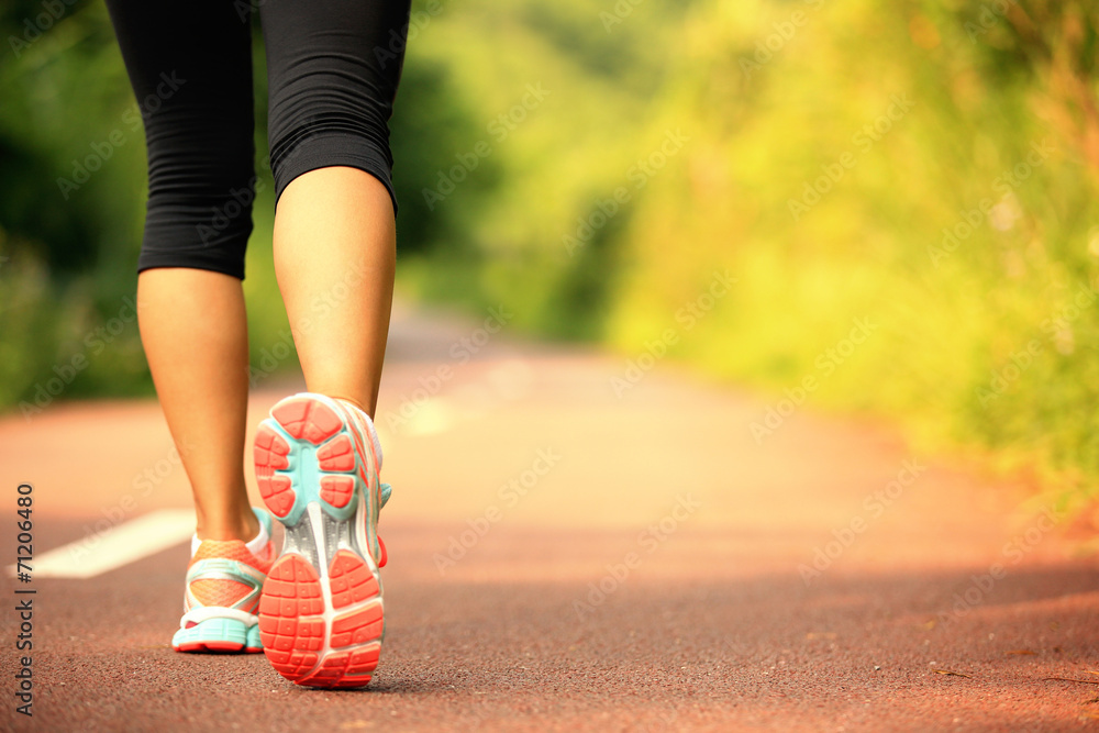 Fototapety, obrazy: young fitness woman legs walking on forest trail