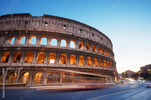 In de dag Rome Colosseum at night, Rome - Italy