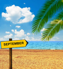 Tropical Beach And Direction Board Saying SEPTEMBER