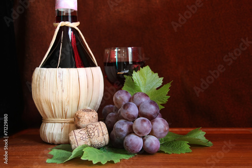 Italian wine Chianti with grape and wine glass Fototapet