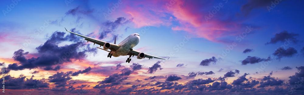 Fototapety, obrazy: Jet plane in a spectacular sunset sky
