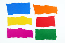 Colorful Torn Paper On White B...