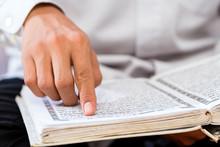 Asian Muslim Man Studying Kora...