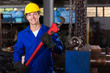 factory worker with monkey wrench