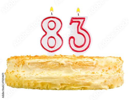 Poster  birthday cake with candles number eighty three isolated on white
