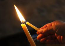 Lighting The Candle For Pray