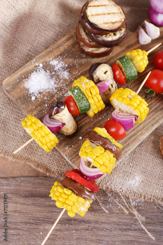 Poster Confiserie Sliced vegetables on wooden picks and bread on table close-up