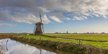 Wooden Wind Mill In A Dutch Polder