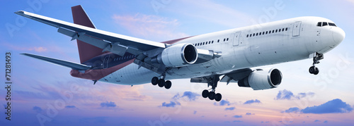 Aircraft is in a sunset sky Canvas Print