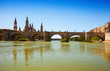 antique stone bridge over Ebro river in Zaragoza