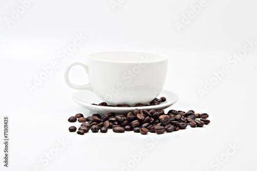 Brown coffee beans and coffee cup isolated on white background