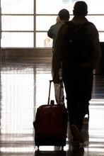 Passengers Walking Through A B...