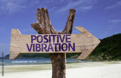 Fotografie, Obraz  Positive Vibration wooden sign with a beach on background