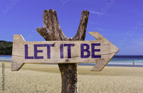 Let It Be wooden sign with a beach on background Canvas Print