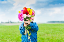 Beautiful Bouquet Of Flowers Holding By Cute Toddler Boy