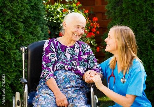 Fotografie, Obraz  Caring for the Elderly in Wheelchair