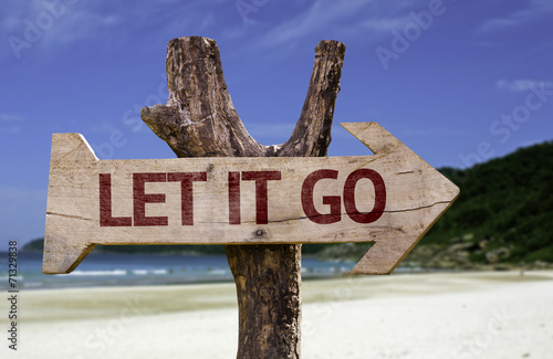 Let It Go wooden sign with a beach on background Poster