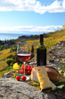 Red wine, cheese, bread and cherry tomatoes. Lavaux, Switzerland