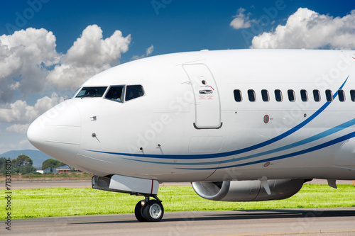 Fotografia  Passenger aircraft taxing to take off