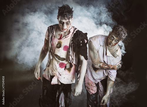 Canvastavla  Two male zombies standing on black smoky background