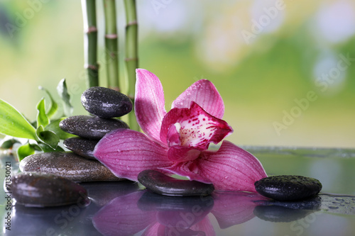 Photo sur Plexiglas Zen pierres a sable Spa stones, bamboo branches and lilac orchid