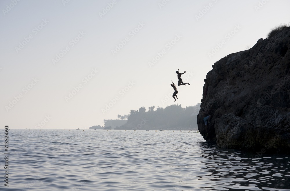 Fototapety, obrazy: People jumping into the water from cliff