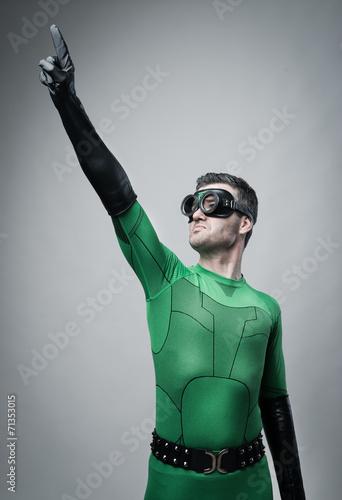 Fotografering  Brave superhero pointing to the sky