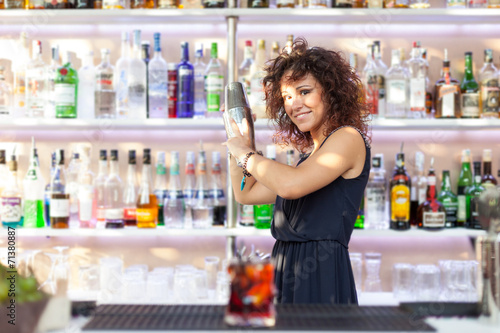 Young barmaid inside Be Towers bar in Budrio, Bologna, Italy. Th Canvas Print