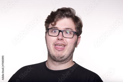 Fototapety, obrazy: Joven con gafas haciendo mueca