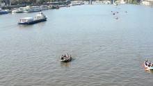 People On Board And Paddling -...