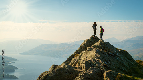 hikers on top of the mountain enjoying view, Highlands, Scotland Fototapeta