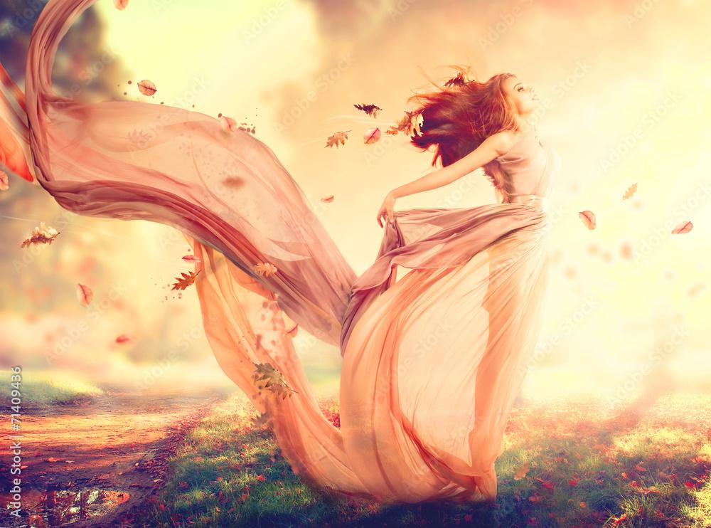 Fototapeta Autumn fantasy girl, fairy in blowing chiffon dress
