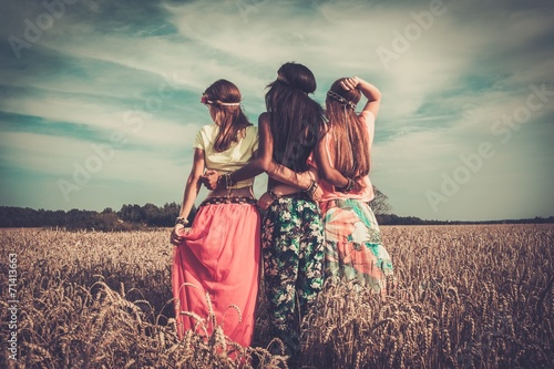 Multi-ethnic hippie girls  in a wheat field Canvas Print