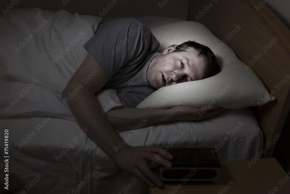 Fototapeta Mature man cannot get to sleep