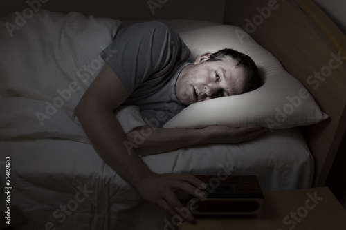 Photo  Mature man cannot get to sleep