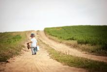 Little Boy Walking In Nature