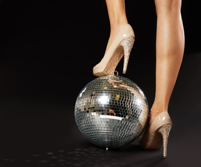 Fototapeta Woman's Foot Over Disco Ball
