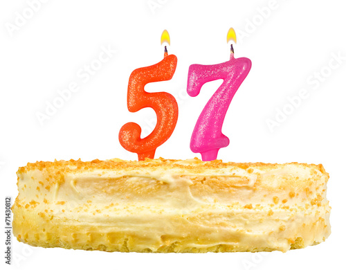 Photo  birthday cake with candles number fifty seven isolated on white