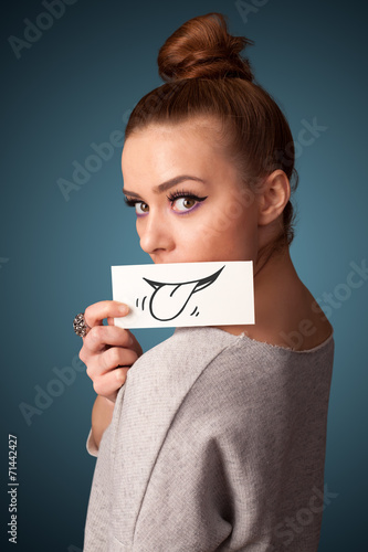 Canvas Prints Textures Pretty young girl holding white card with smile drawing