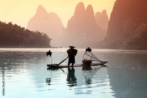 Fototapeta Chinese man fishing with cormorants birds obraz