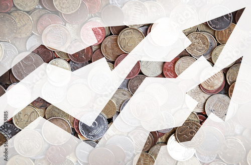 Fotografía  Different countries coins background with growing trends arrows