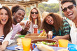canvas print picture - Group Of Young Friends Enjoying Lunch Outdoors