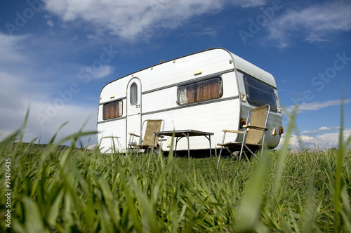 caravan camping with table and two chars Plakat